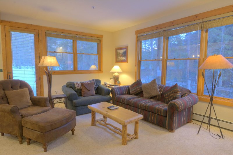 "SkyRun Property - ""8782 Trappers Crossing"" - Living Room - Relax after a long day in the spacious living room in front of the roaring gas fireplace. - 8782 Trappers Crossing - Keystone - rentals"