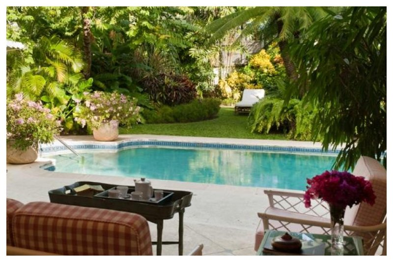 Grand 5 bedroom colonial style home surrounded by lush tropical gardens and great access to the nearby beach - Image 1 - Maynards - rentals