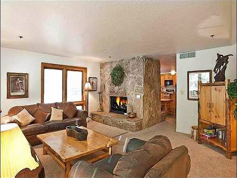 The Living Area Features a Beautiful Stone Fireplace and Welcoming Furnishings - Beautiful Mountain Views - Just a Short Drive to Shopping and Dining (18014) - Park City - rentals
