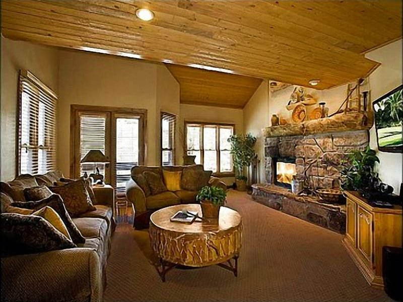 The Living Room has a Flat-Screen Cable TV and a Stone Fireplace - Beautiful Mountain Views - Close to Historic Main Street (24666) - Park City - rentals
