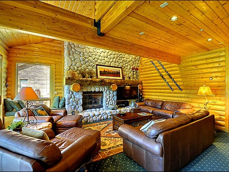 The Living Room Features a River-Rock Fireplace and Hand Peeled Log Walls - Views of the Ski Run - Rustic Mountain Elegance (24778) - Park City - rentals