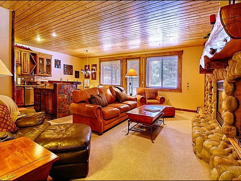 The Living Room has a Stone Fireplace and Comfortable Leather Furniture - Across the Street from Slopes - Near Elegant Restaurants & Shops (24777) - Park City - rentals