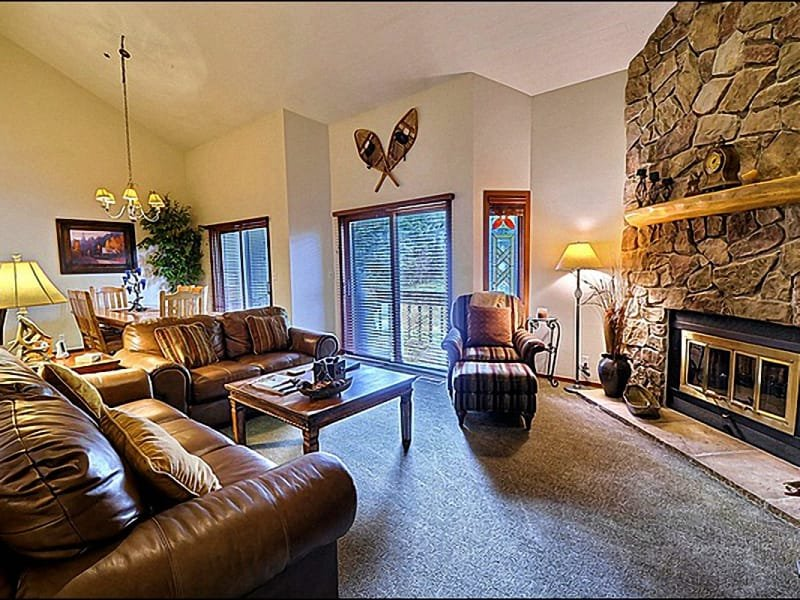 The Spacious Living Room Features a Stone Fireplace and a Flat Screen HDTV - At the Base of Deer Valley Resort - Near Main Street (24779) - Park City - rentals