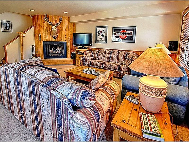 The Living Room has a Fireplace and Hardwood Accents - Walking Distance from Main Street - Cute and Cozy Condo (24786) - Park City - rentals