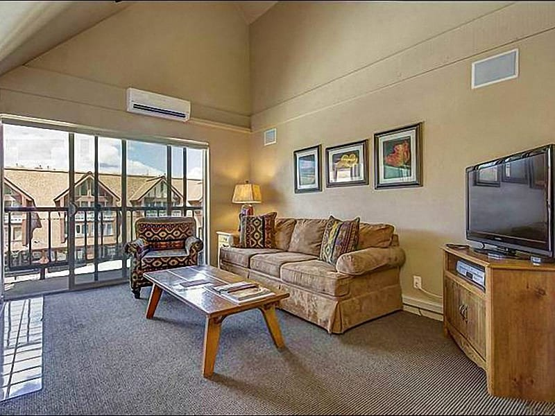Sunny Living Room Includes a Flat-Screen TV, Gas Fireplace, and Balcony Access - Beautiful, Centrally Located Condo - Updated with Magnificent Finishes  (24919) - Park City - rentals