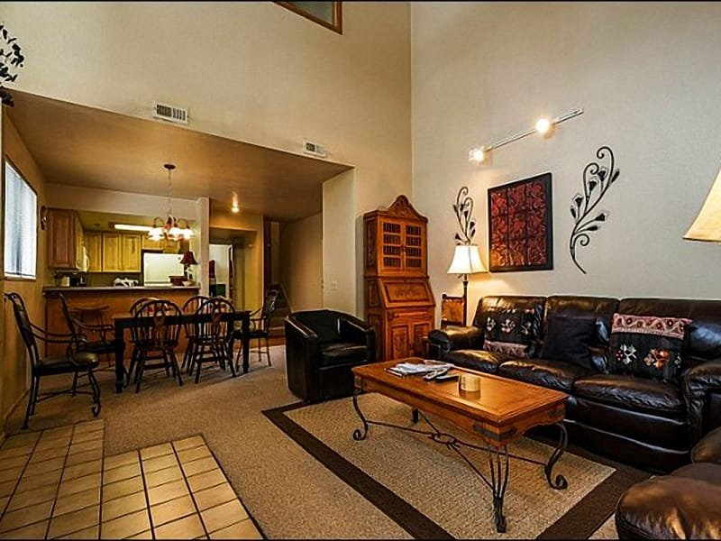 Living Room Includes High Ceilings and a Gas Fireplace and it Opens to the Dining Area - Great Value Lodging - Conveniently Location at the Base of the Resort (24958) - Park City - rentals