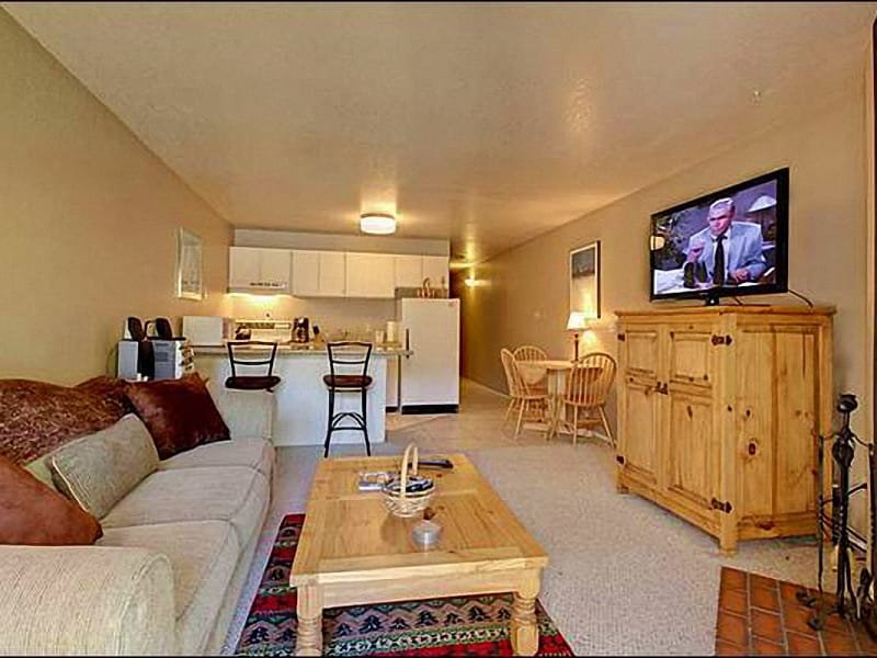 Living Room Includes a 42-Inch Flat-Screen TV and Fireplace - Second-Floor Vacation Condo - Slope & Golf Course Views (24977) - Park City - rentals