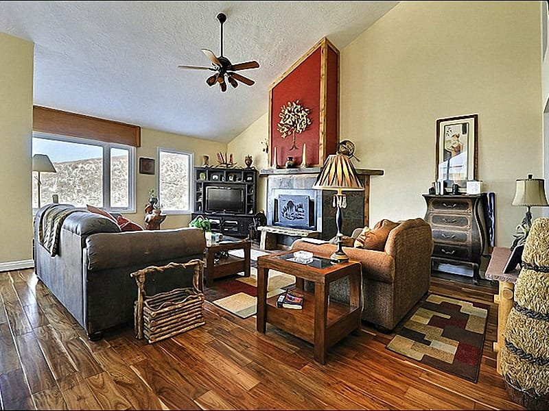 Spacious and Open Living Room Features a Flat-Screen TV and Wood-Burning Fireplace - Remodeled & Beautiful Home - Close to Shops & Nightlife (25007) - Park City - rentals