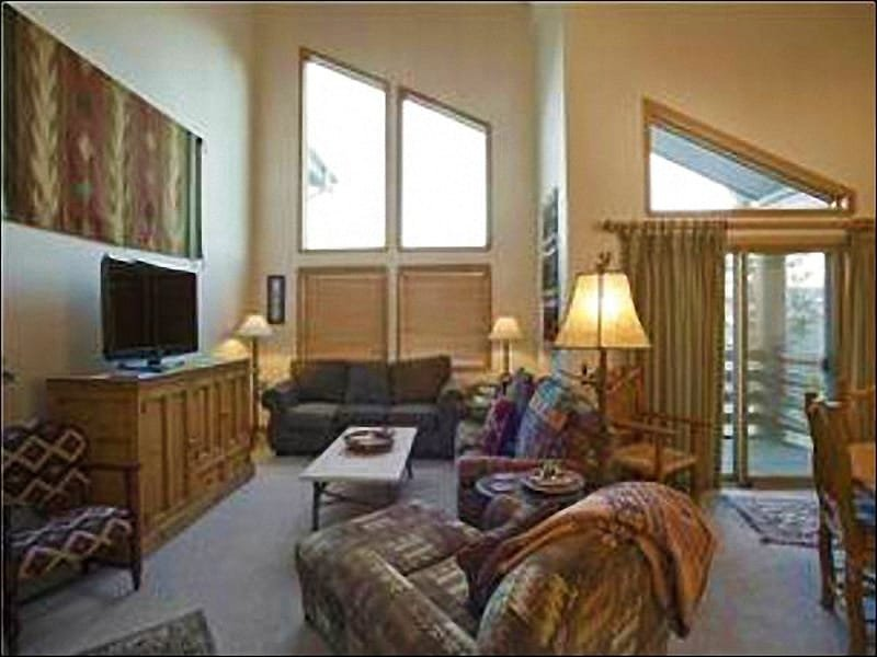 Vaulted Ceilings, a Fireplace, and a Flat-Screen TV in the Living Room - Centrally Located Townhome - Lovely Views (25026) - Park City - rentals