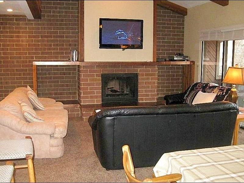 Living Room Features a Flat-Screen TV and a Gas Fireplace - Beautifully Upgraded & Refurbished Condo - Magnificent Slope Views (25066) - Park City - rentals