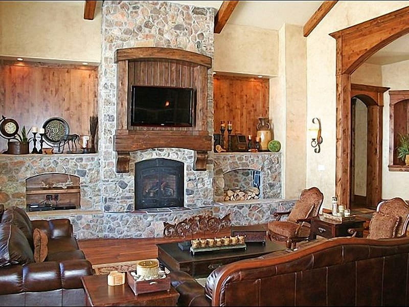 Living Room Boasts Timber and Stone Finishes, a Flat-Screen TV, and Fireplace - Opulent Home with Incredible Architectural Details - Perfect for Entertaining Large Groups (25069) - Park City - rentals
