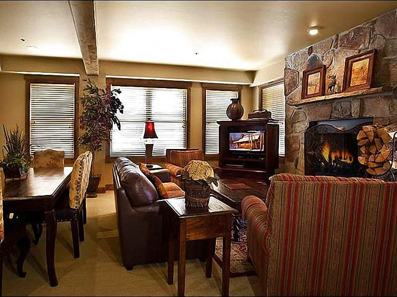 Inviting Living Room Boasts a Flat-Screen TV and Wood-Burning Fireplace - In the Heart of Silver Lake Village - Luxurious Accommodations & Amenities (25321) - Park City - rentals