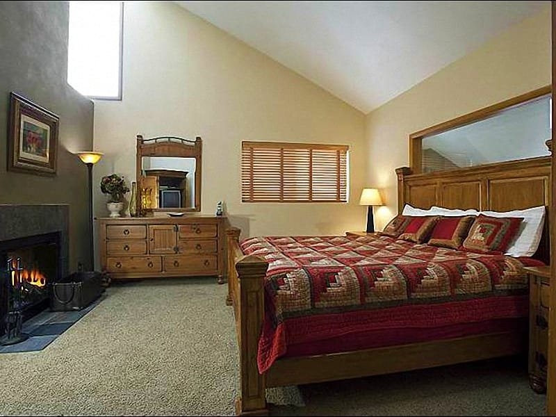 Master Bedroom Boasts a King Bed, Wood-Burning Fireplace, and Private Bath - Spacious Red Pine Townhome - Close to the Resort Village (25335) - Park City - rentals