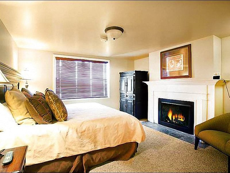 Master Bedroom Features a King Bed, Fireplace, and Private Bath - Convenient Base Village Location - Remodeled & Upgraded (25341) - Park City - rentals
