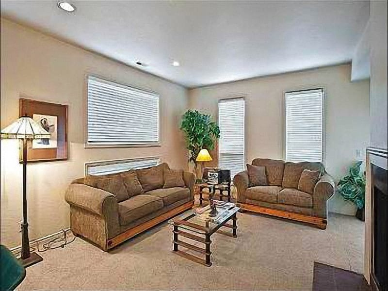 Living Room with Wood Burning Fire Place - Scenic Views - On-Site Pool, Hot Tub and Sauna (25378) - Park City - rentals