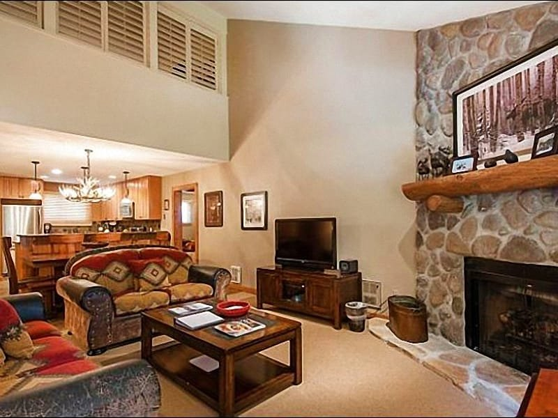 The Living Area Features a Beautiful Stone Fireplace and Cozy Furnishings - Beautiful Ski Resort Views - Common Area Hot Tub and Swimming Pool (5131) - Park City - rentals