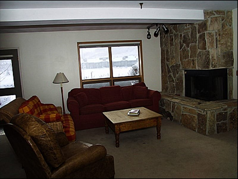 Living Room - Rock Fireplace, Patio Access - Beautiful Views of Lower Deer Valley - Great Location & Value (7039) - Park City - rentals