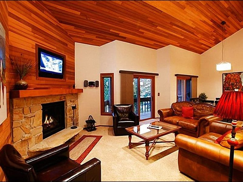 Living Room has a Stone Fireplace and Beautiful Wood Accents - Newly Remodeled Condo - Designer Furnishings and Fixtures (7304) - Park City - rentals