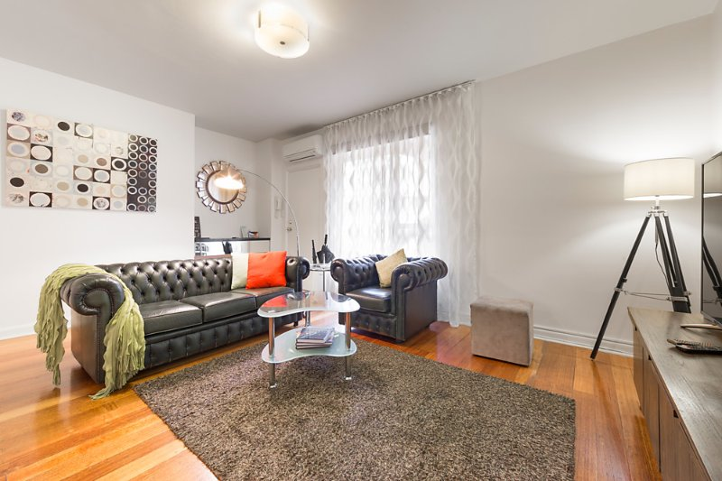 "Living area with reverse-cycle air-con, 60""UHD Smart TV, double glazing & block-out blinds - StayCentral Brunswick & Parkville; CBD trams shops cafes restaurants parks quiet - Brunswick - rentals"