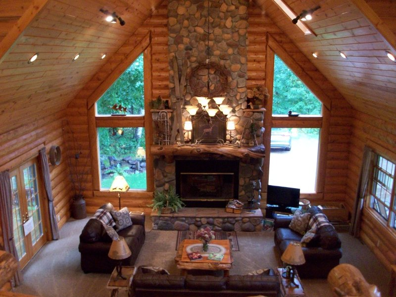Enjoy a book by the fire of a two story rock wood burning fireplace! Nothing like a real fire! :) - Rustic Lodge ( not on a lake) - Shell Lake - rentals