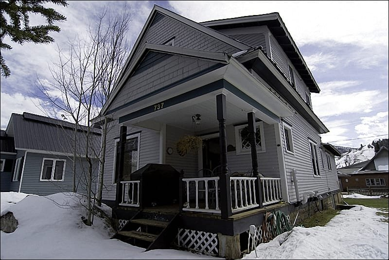 Exterior showing Front Porch with Chairs, Table, & Gas Grill. - Beautiful Victorian Home 2 Blocks off Main Street - Discounted Rates for Longer or Last Minute Stays (3602) - Steamboat Springs - rentals