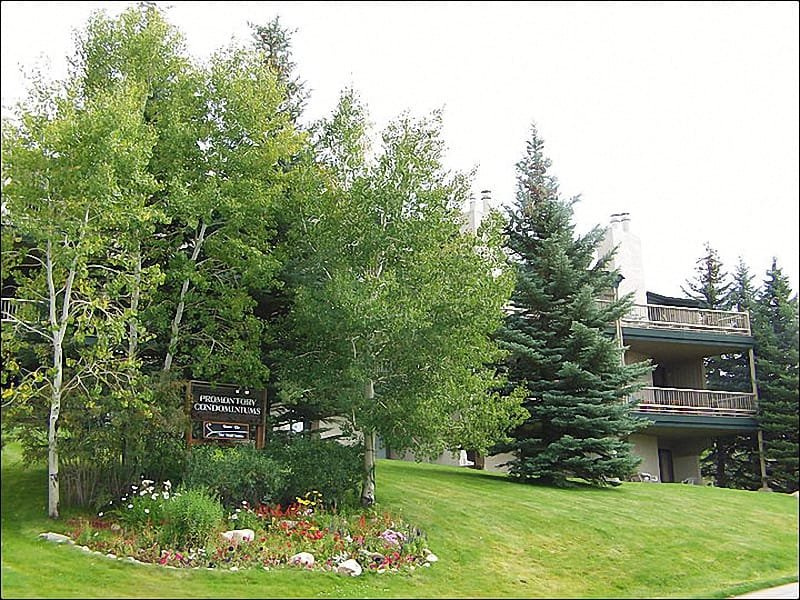 Exterior View of this End Unit condo shows the large deck & lower patios. - Available as a 3 or 4-Bedroom - Heated Pool & Hot Tub, Great Views (3841) - Steamboat Springs - rentals