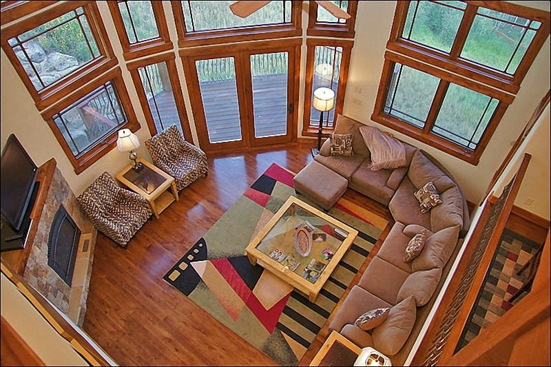 "Living Room - 44"" HDTV, Fireplace, 25 Foot Vaulted Ceilings, & Deck. - Adjacent to Property 9976, 1/2 of Property 9977 - Mountain Architecture & Decor, Upscale Appliances (9975) - Steamboat Springs - rentals"