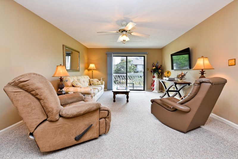 Living room with queen size sofa bed, two recliners and 50 inch flat screen tv on the wall. - Cozy Beach Condo-Just steps from the beach! - Surfside Beach - rentals