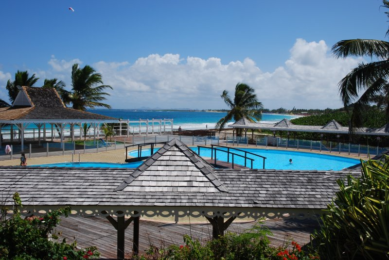 Sunset view, Orient beach condo with pool - Image 1 - Orient Bay - rentals