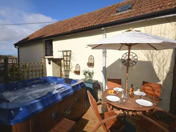 Enjoy the decked area with hot tub and seating area - LINOR - Newton Tracey - rentals