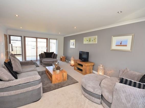Contemporary lounge with patio door to decked terrace  - FCH11582 - Borthwick - rentals