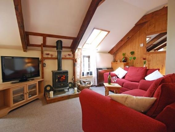 Lounge area with woodburner - NPHON - Poundstock - rentals