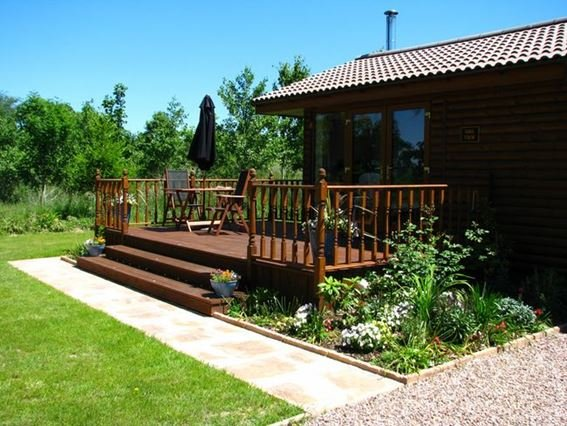 View towards the lodge with decked area - OAKVI - South Molton - rentals