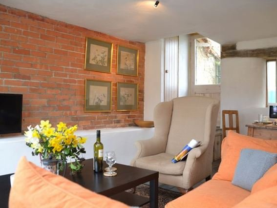 Lounge area with french doors to private patio area to the side - CIBAR - Wootton Fitzpaine - rentals