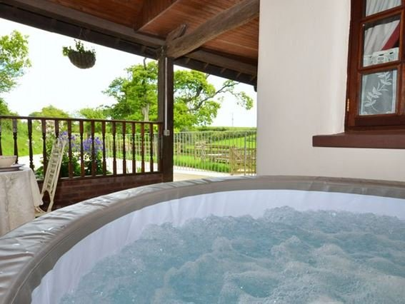 Decked area at the front of the property with hot tub - STITC - North Devon - rentals