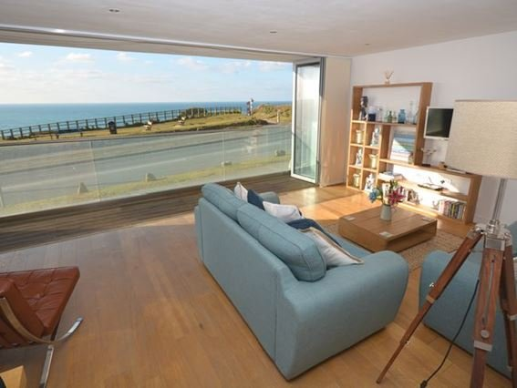 Lounge area with bi-folding doors to the balcony - ZENAP - Cornwall - rentals