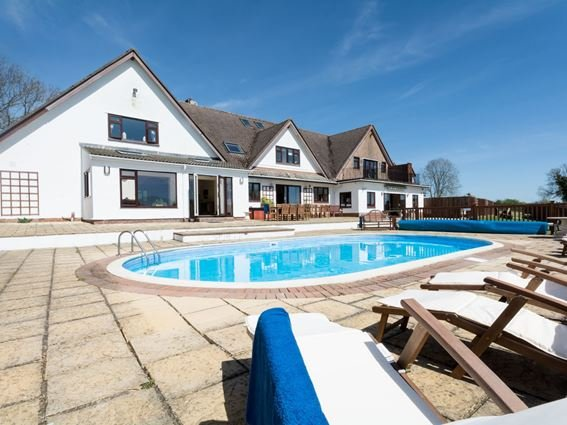 External view of property with outdoor heated pool - RANMO - Dorset - rentals
