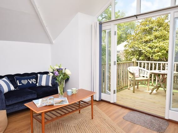 Patio doors leading from the lounge to the raised decked area - ACOUR - Appledore - rentals