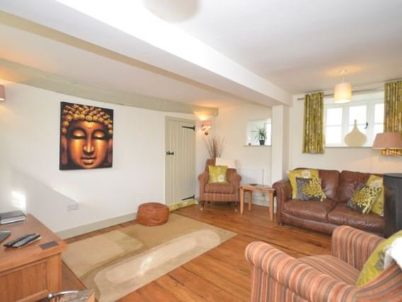 Lounge with cosy woodburner leading to kitchen - GHILS - Knowstone - rentals