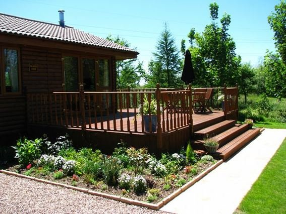 View towards the lodge with decked area - ISLVI - South Molton - rentals