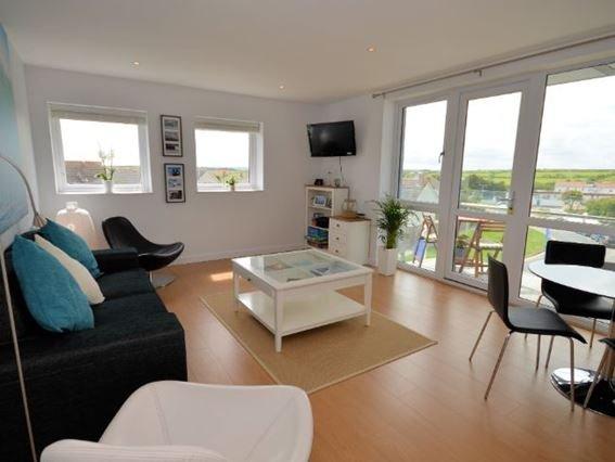 Open-plan lounge/kitchen/diner with doors to balcony - PADOU - Cornwall - rentals