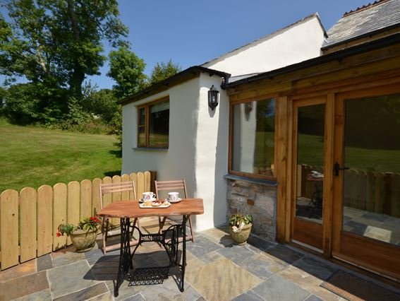 View towards the property and enclosed patio with seating - MFARM - Cornwall - rentals