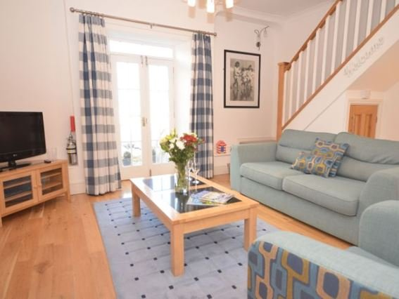 Lounge with doors leading to the terrace with harbour views  - HBEAC - Ilfracombe - rentals