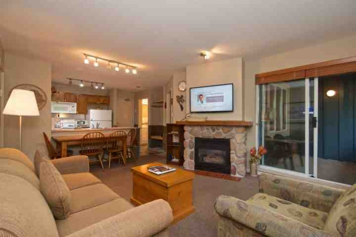 Spacious living room with gas fireplace and wall mounted TV - Eagle Lodge 2Bed, 2 Bath Eagle Lodge Condo with beautiful Mountain View unit # 432 - Whistler - rentals