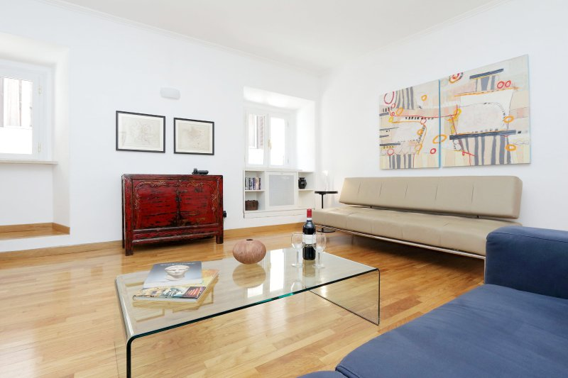 Living room - spacious and light, with modern furniture and beautiful artwork. - The Spanish Steps Apartment - Free Airport Pickup! - Rome - rentals