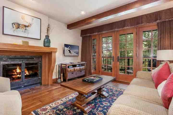 "Sunken living room with wood burning fireplace, 40"" flat screen TV/DVD and access to deck overlooking the creek. - Creekside at Beaver Creek Condo, Walk to Village, Ski In/Ski Out, Communal YR Hot Tub, Seasonal Pool - Avon - rentals"