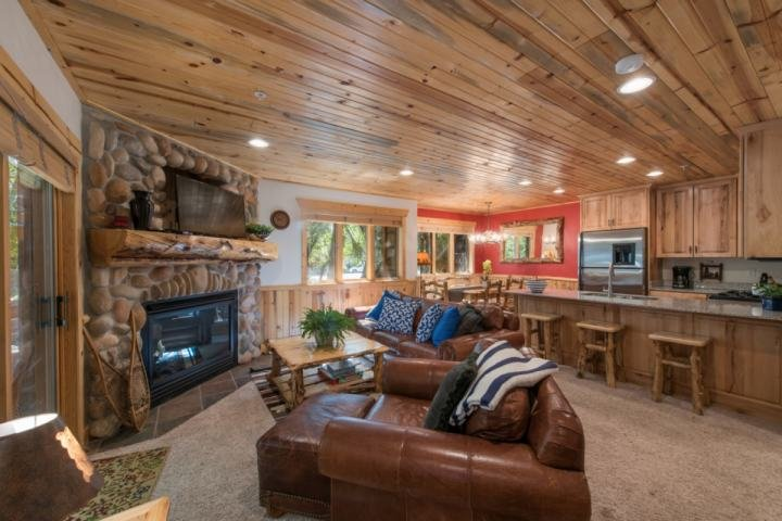 "The open concept living area features comfortable furnishings, 45"" HDTV with entertainment center and floor to ceiling river rock fireplace. - Timber Wolf Mountain View - Park City - rentals"