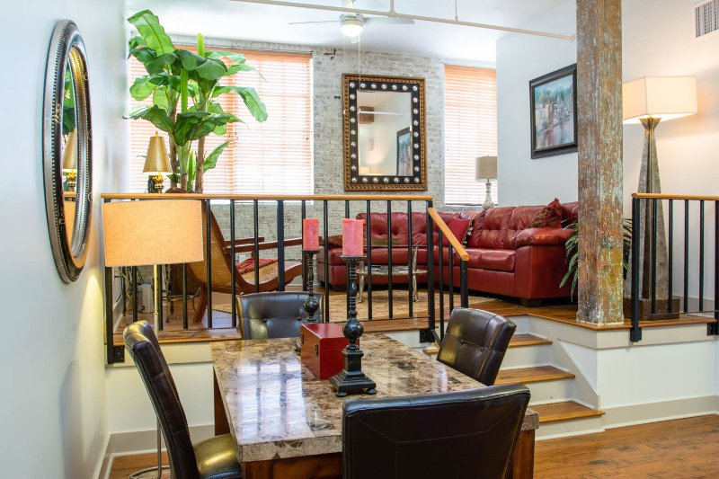 Beautifully furnished living/dining spaces - Luxury French Quarter Rental 50 ft off Bourbon w/Pool & Gym - Maison Katrina - New Orleans - rentals