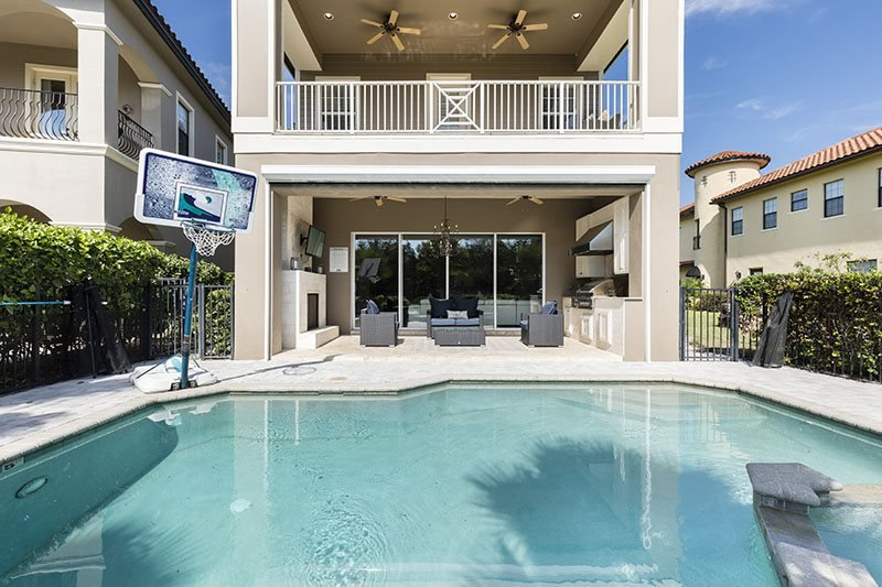 Castle Pines Paradise | Luxury 4 Bed Villa Located off the 2nd Hole of Tom Watson Golf Course featuring a Pool with Summer Kitchen, Games Room, 2 Fireplaces & Designer Furniture - Image 1 - Kissimmee - rentals