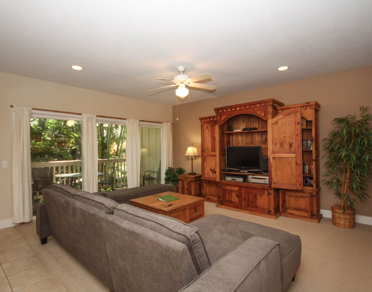 Living Room and Lanai - Regency 812 Beautifully appointed 2bd air conditioned condo in the heart of Poipu close to beaches. Free car with stays of 7 nights or more.* - Koloa - rentals
